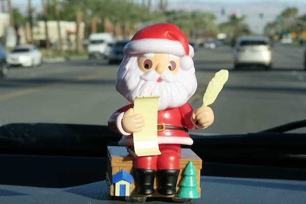 Solar Dancing Santa blessing the dash of our truck - Palm Spring, California