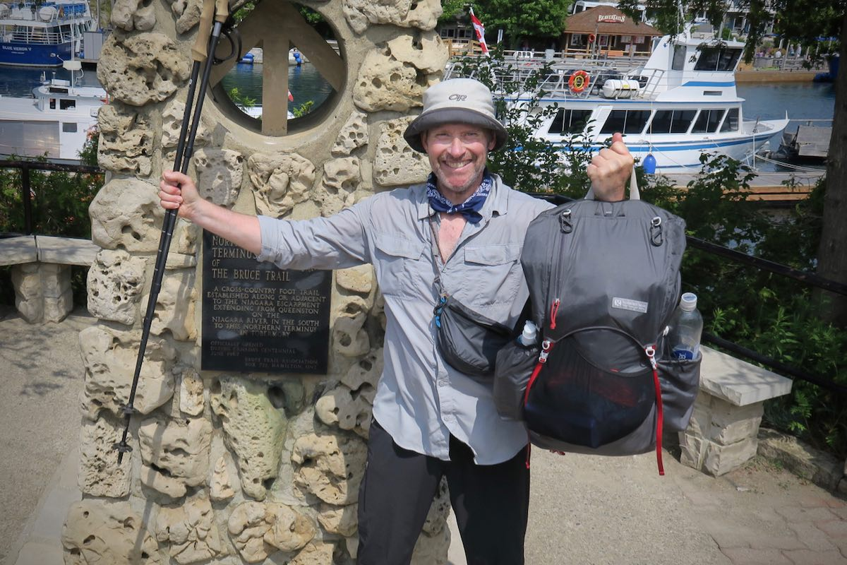 Bruce celebrating the completion the 900 kms Bruce Trail at the northern terminus in Tobermory